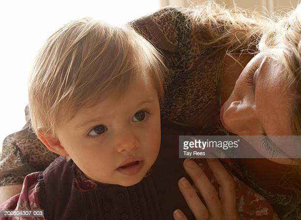 Woman with baby girl (12-15 months), close-up