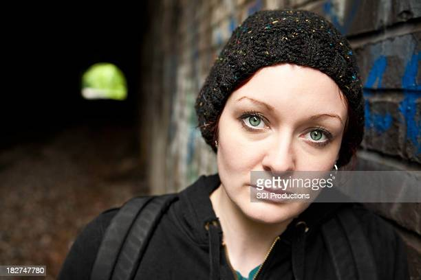 Woman with Backpack Next to Tunnel