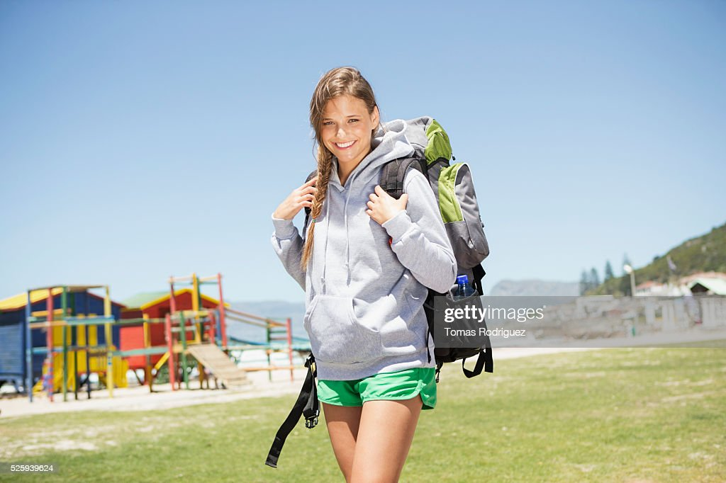 Woman with backpack standing near beach : Stock Photo