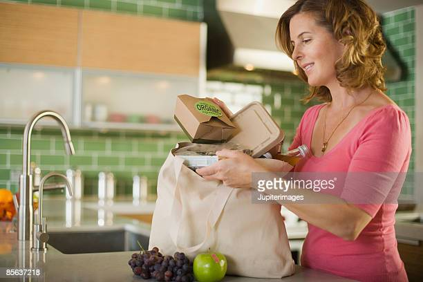 Woman with bag of organic takeout food