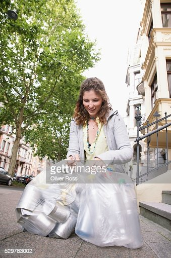 Woman with Bags for Recycling : Stock-Foto
