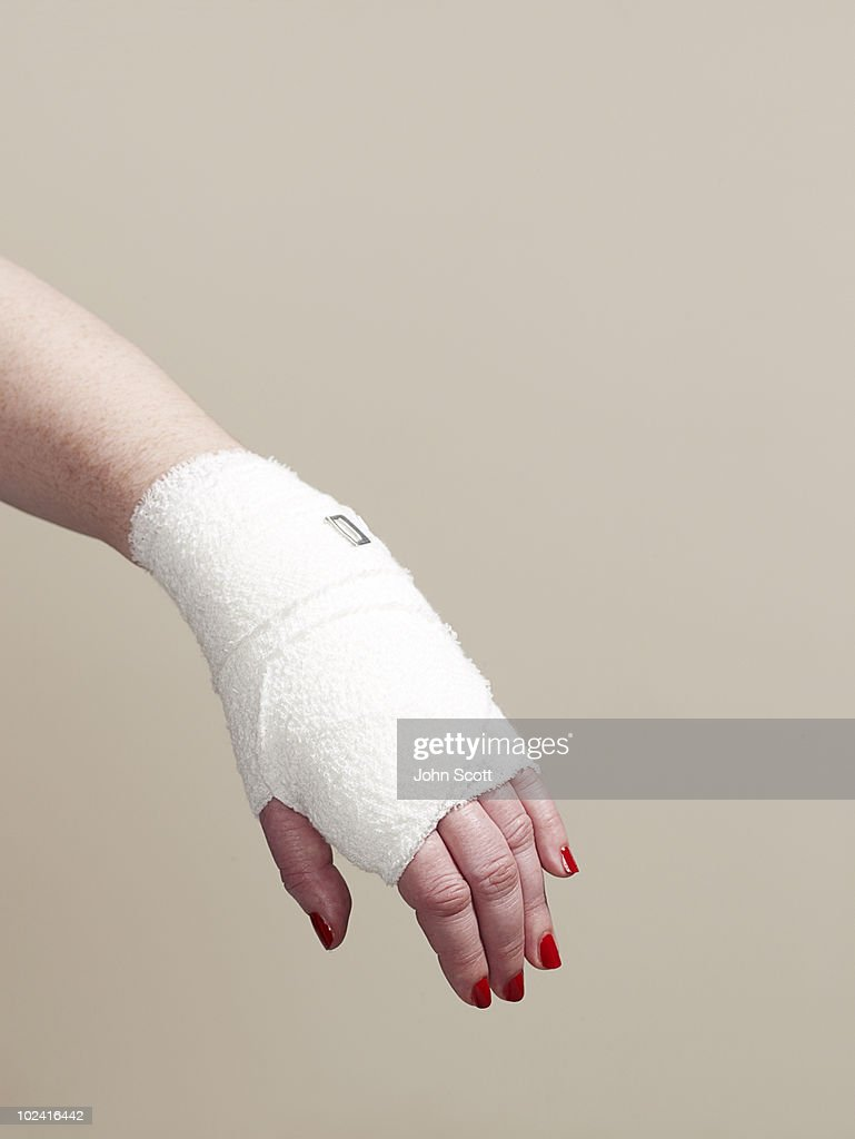 Woman with bandaged hand, close-up of hand