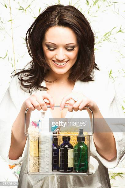 Woman with Basket of Bath and Beauty Products