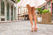 Woman with beautiful legs wearing high heel shoes in old city