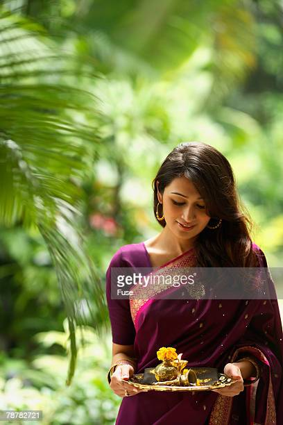 Woman with Beautiful Sari and Offerings