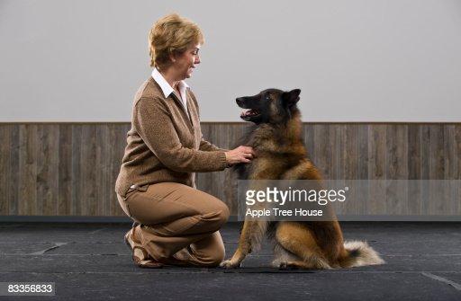 Woman with Belgian Tervuren : Stock Photo