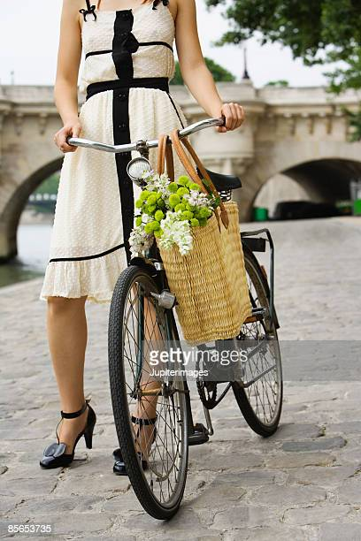 Woman with bicycle , River Seine , Paris , France