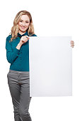 Smiling woman with big blank board . Close up female face portrait with arms on blank card.