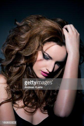 Woman with big hair looking down, portrait. : Foto de stock