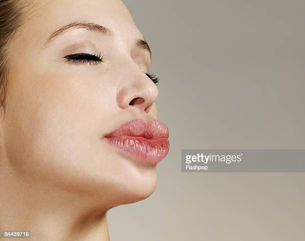Woman with big lips pouting