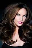 Woman with big shiny hair, portrait.