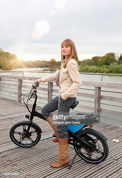 Woman with bike on wooden walkway