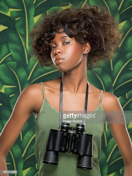 Woman with binoculars around her neck