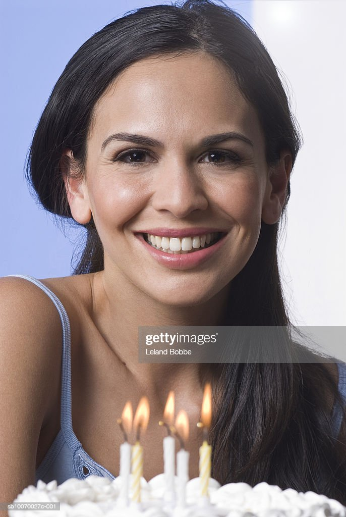 Woman with birthday cake smiling, close-up, portrait : Stock Photo