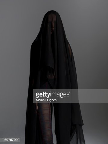 Woman with black silk covering her over her head : Stock Photo