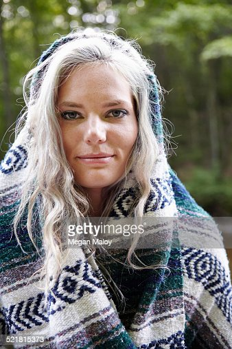Woman with blanket around her