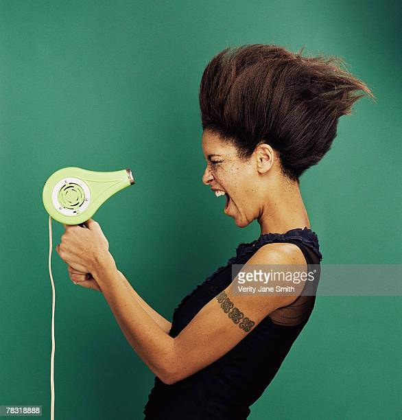 Woman with blow dryer