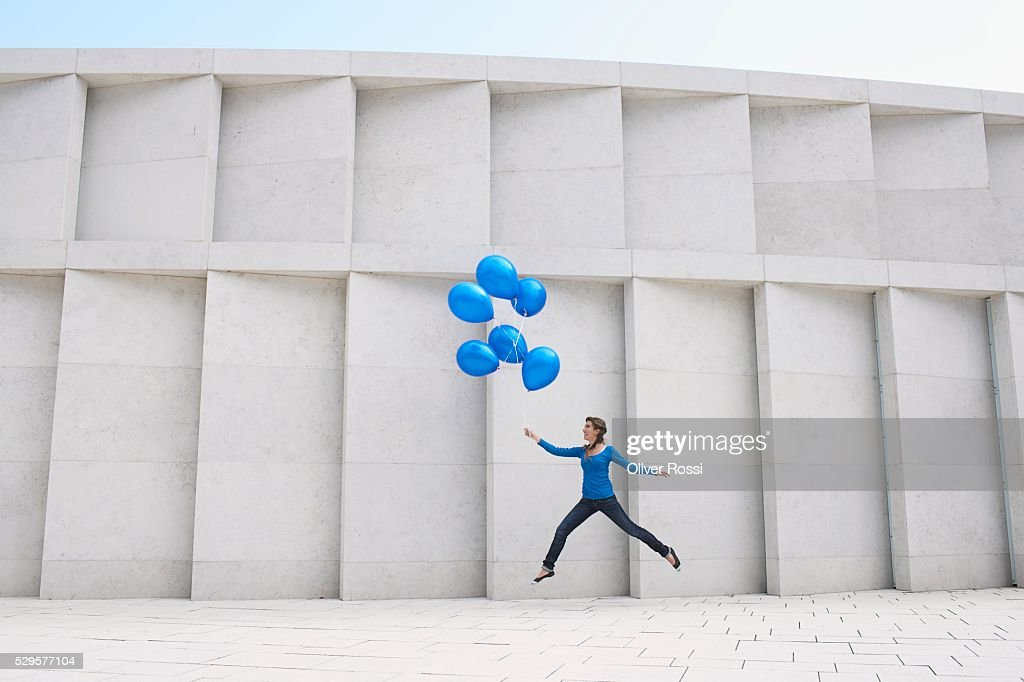 Woman with Blue Balloons : Bildbanksbilder