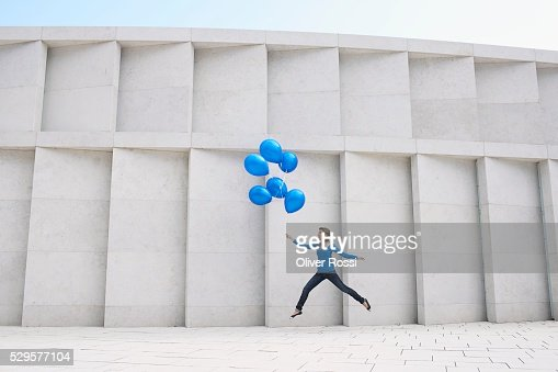 Woman with Blue Balloons : Stockfoto