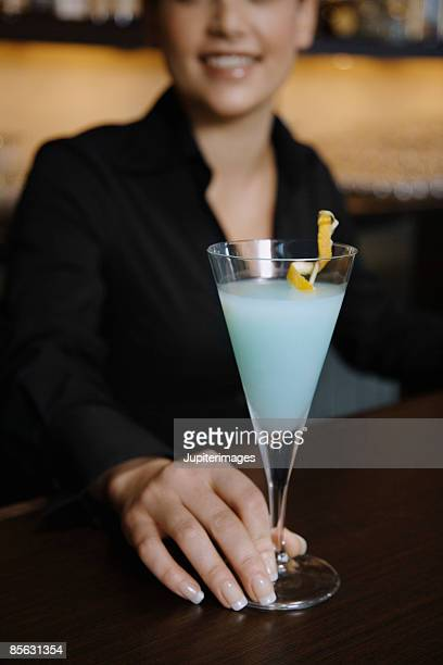 Woman with blue cocktail