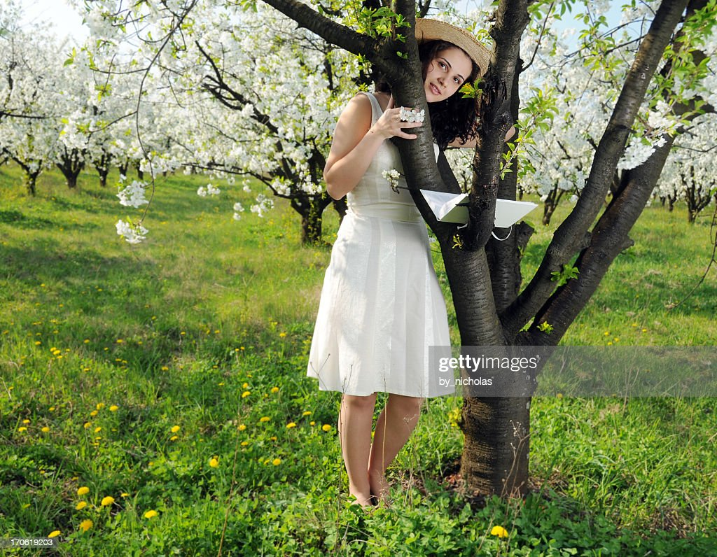 Woman with book in the meadow : Stock Photo