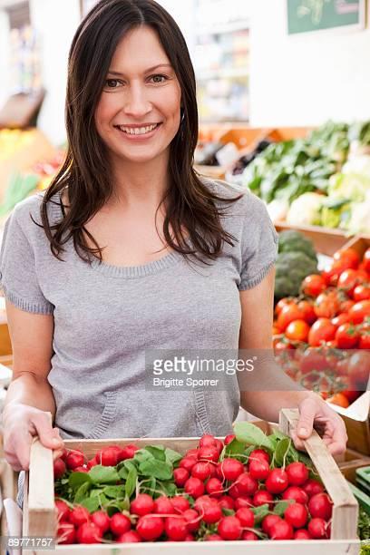 Woman with box of radish