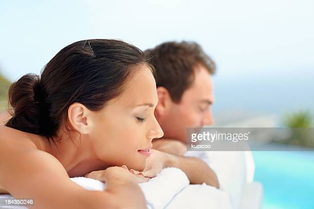 Woman with boyfriend lying at spa