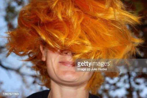 Woman with bright orange hair