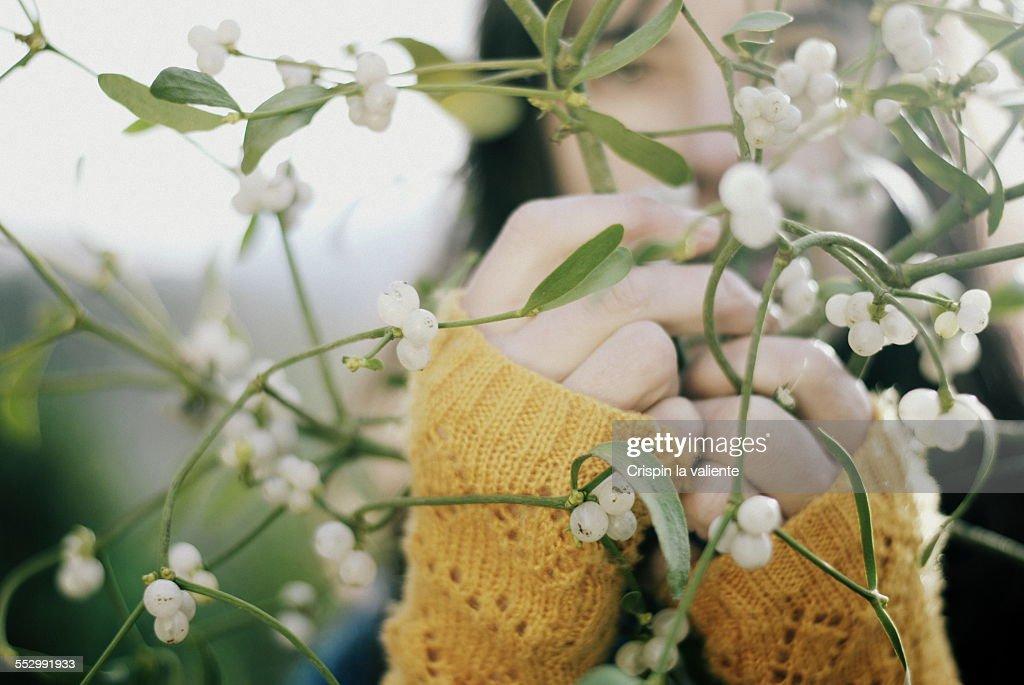 Woman with bunch of mistletoe