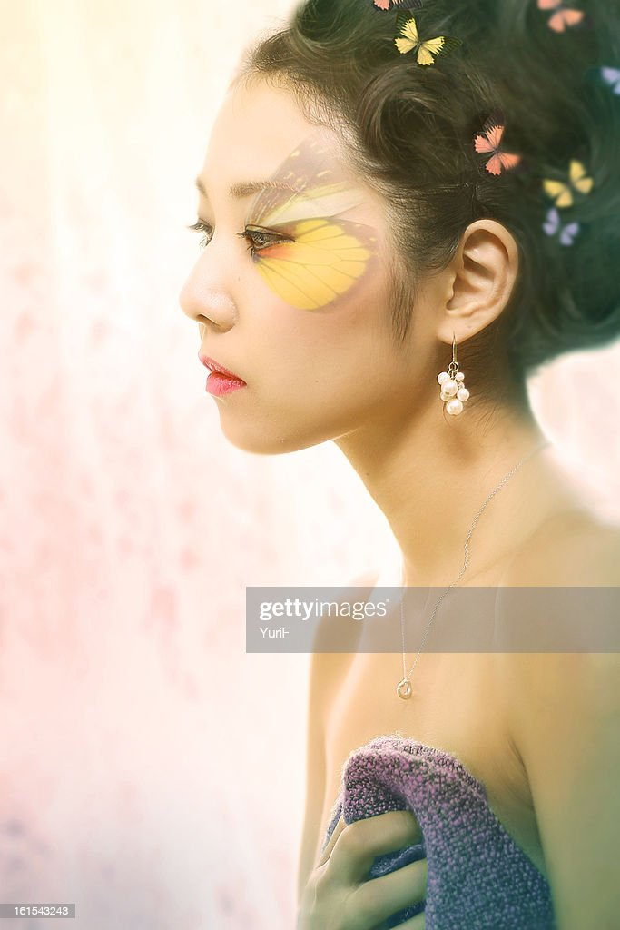 Woman with butterfly makeup. : Stock Photo