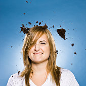 woman with cake falling on her head