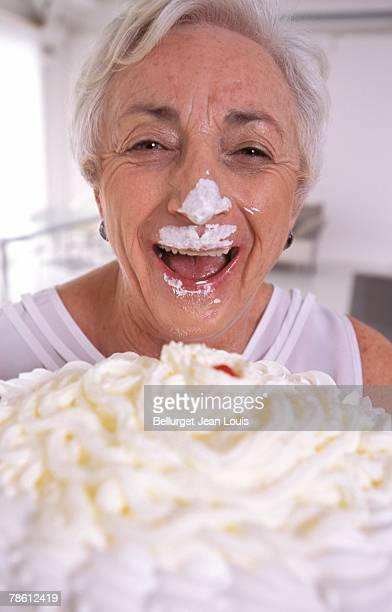 Woman with cake on face
