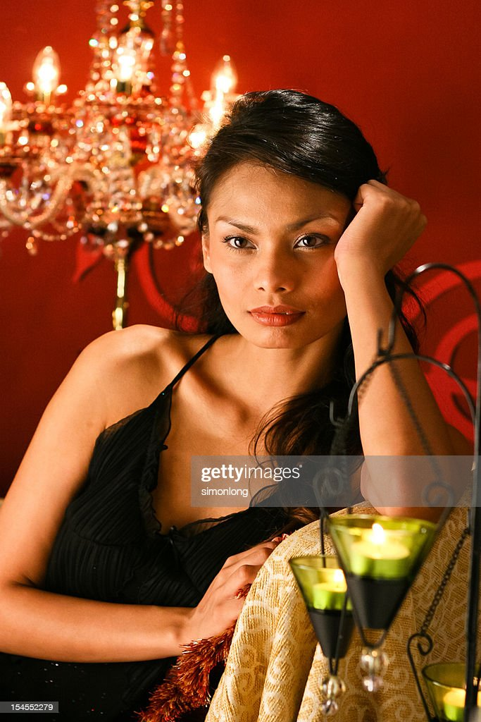 Woman with candle light : Stock Photo
