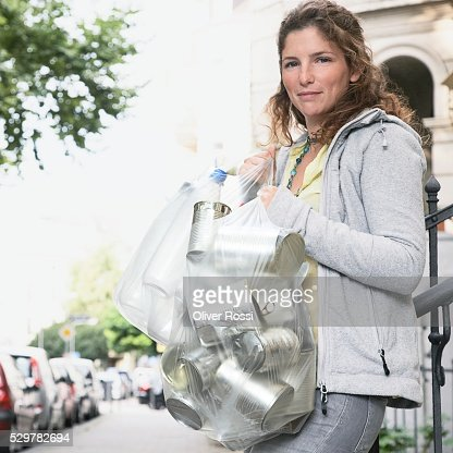 Woman with Cans for Recycling : Stock-Foto