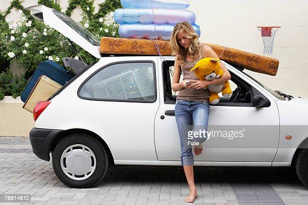 Woman with Car Loaded for Moving