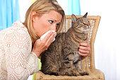Woman with cat and handkerchief indoor