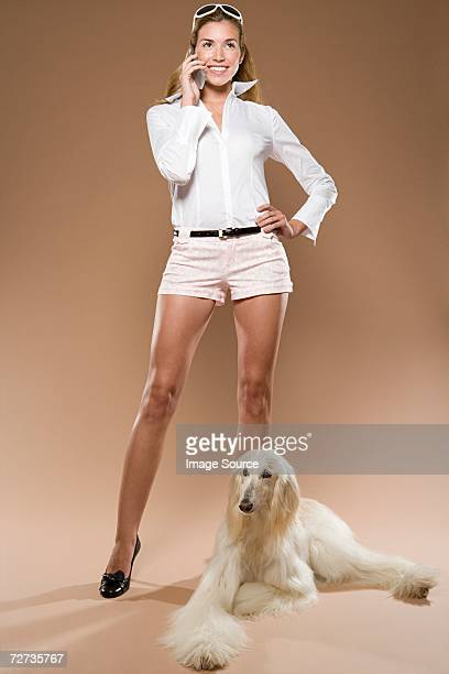 Woman with cell phone and dog