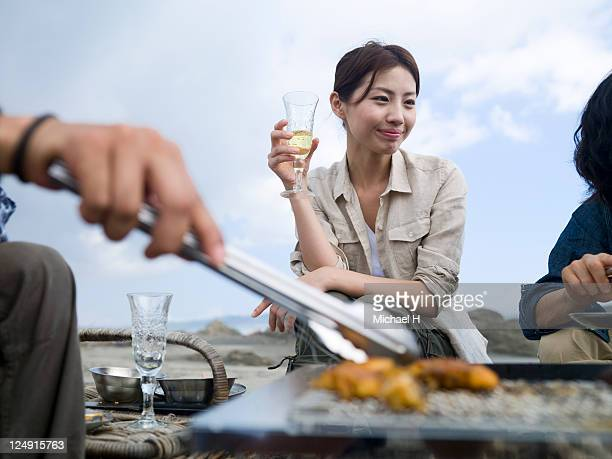 Woman with champagne who seems to be satisfactory