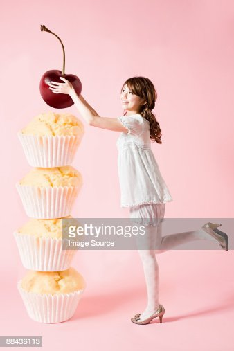 Woman with cherry and cupcakes : Foto de stock