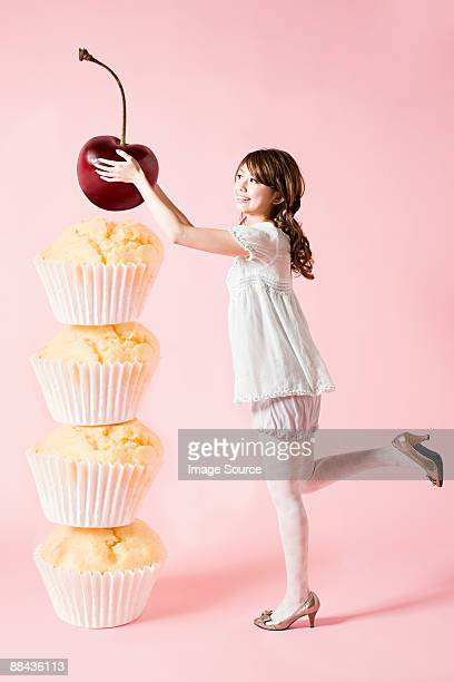 Woman with cherry and cupcakes