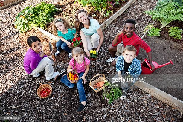 Woman with children in community garden