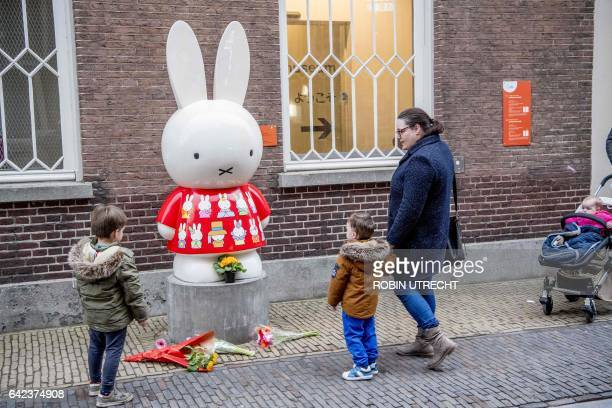 A woman with children stand in front of a statue of Nijntje character called Miffy in English outside the Nijntje Museum in Utrecht on 17 February...