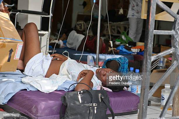 A woman with cholera lays on a bed attached to IVs at St Nicolas Hospital after a cholera outbreak hit the rural countryside October 22 2010 in St...