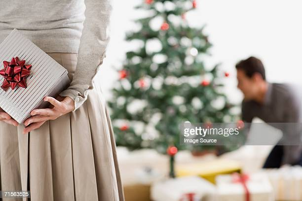 Woman with christmas gift for boyfriend