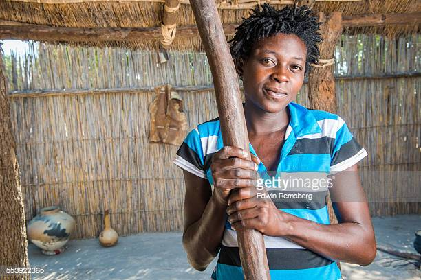 Woman with churn stick
