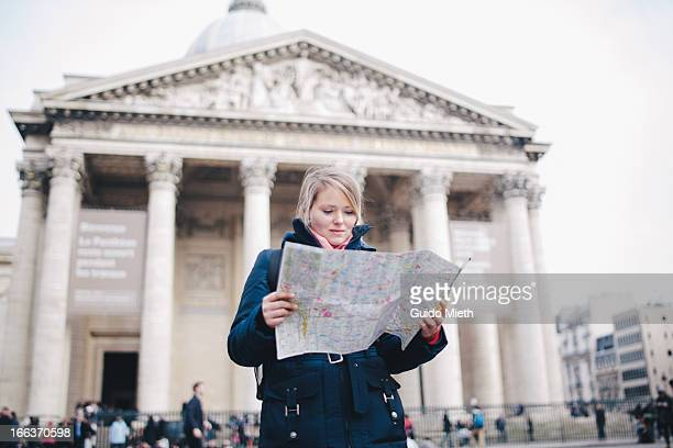 Woman with city map in paris.