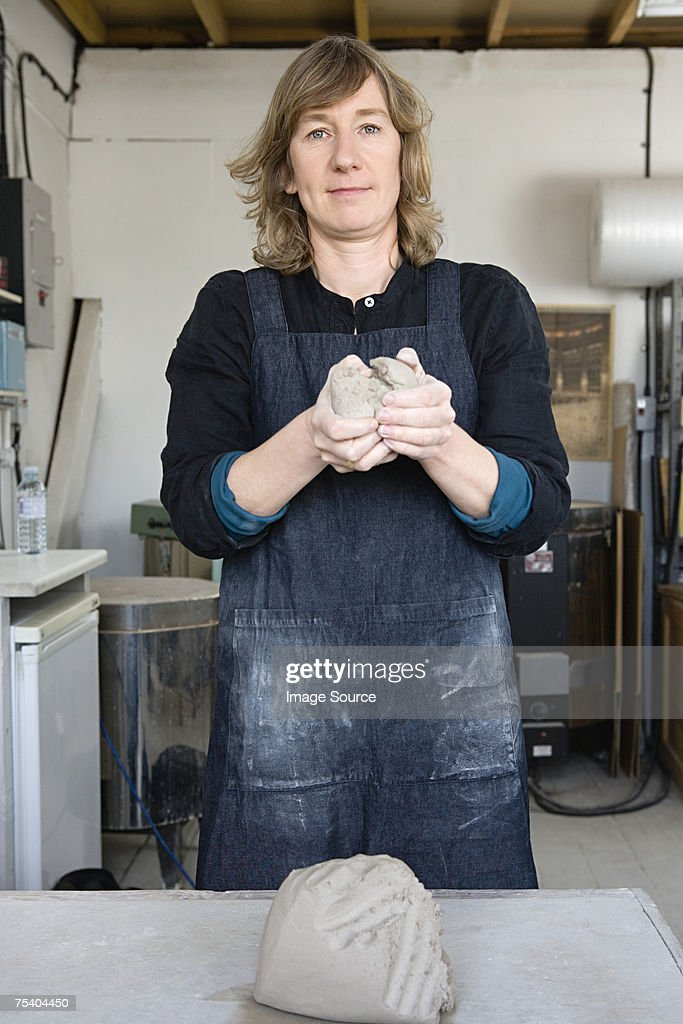 Woman with clay : Stock Photo