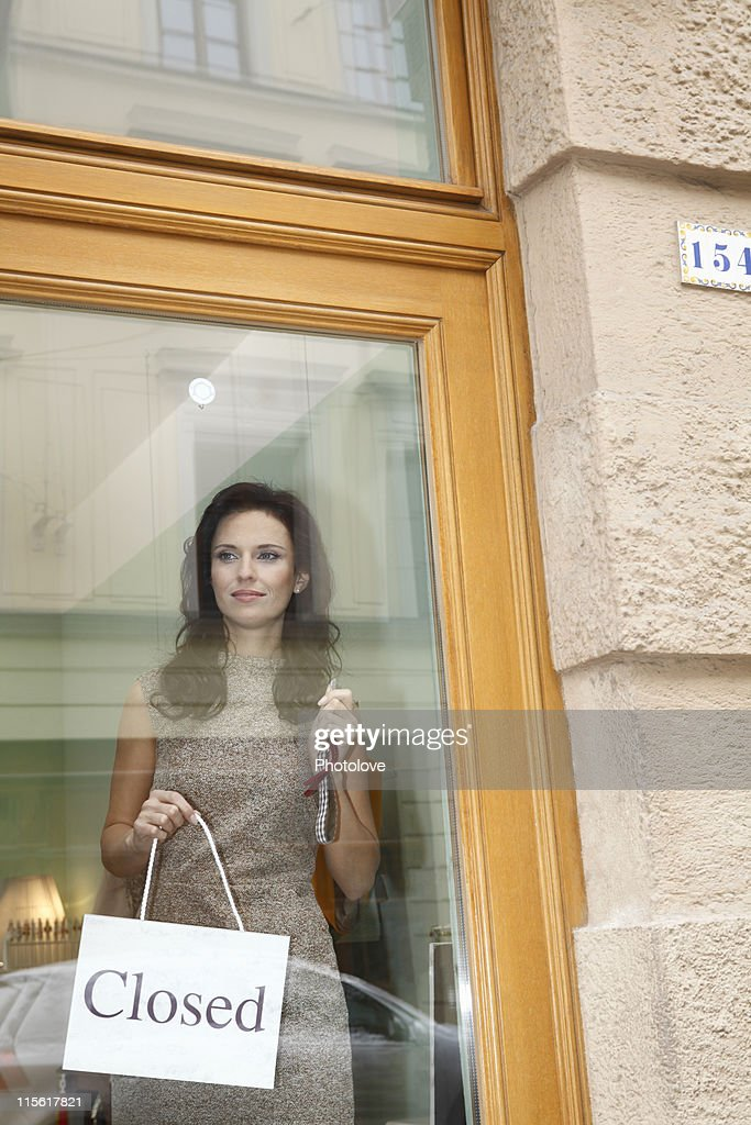 woman with closed sign