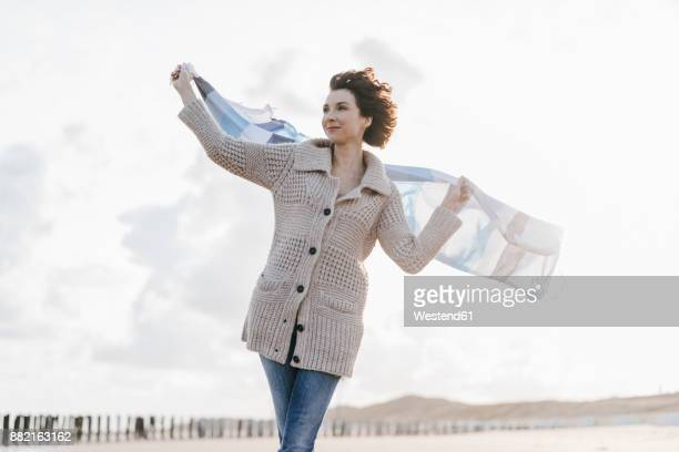 Woman with cloth on the beach