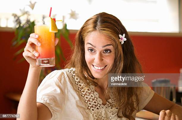 Woman with cocktail in a bar